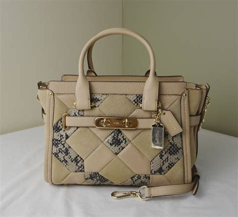 nwt coach 36400 navy patchwork empire carryall satchel dust bag gift rec t what s it worth