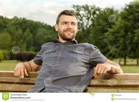 man on the bench man sits on the bench and relax stock photo image 63155461