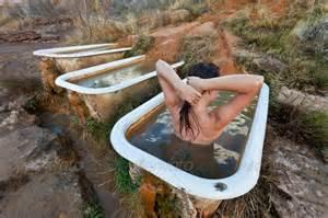 Woman soaking in a rustic hot tub stock photo photodune