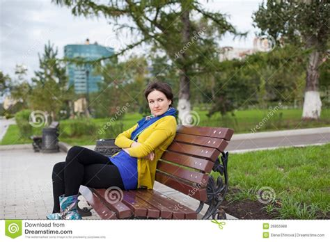 sitting on a park bench the girl is sitting on a park bench royalty free stock photos image 26855988