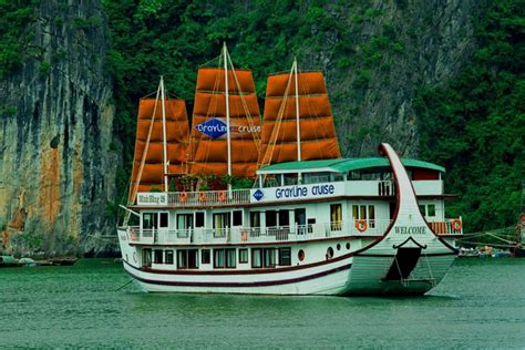 dinner on a boat in the bay halong bay overnight luxury cruise in traditional junk boat