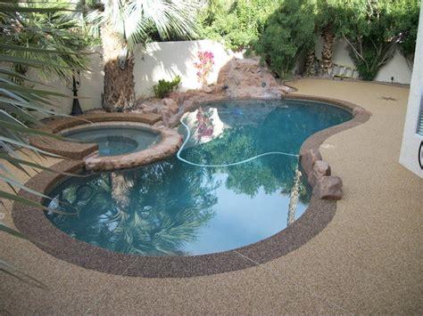 pool deck tropical pool las vegas  pebble stone