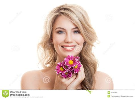 portrait of beautiful smiling woman with flowers clear