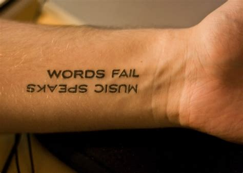 phrase tattoos 25 cool word tattoos creativefan