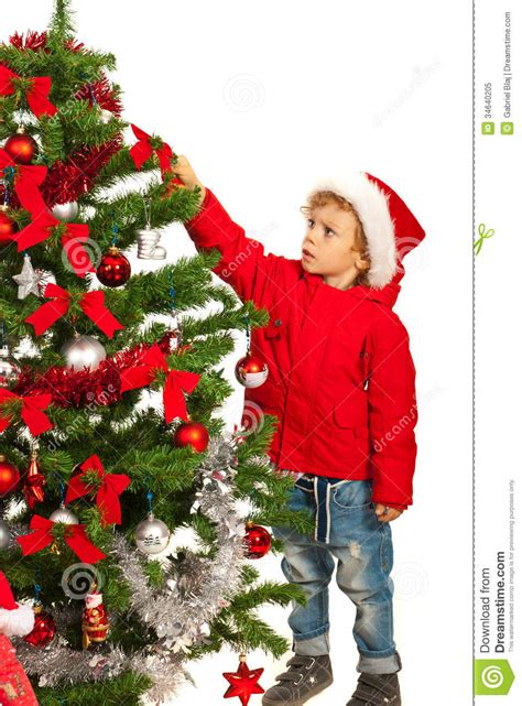 tree with a toddler toddler boy decorate tree stock image image of season