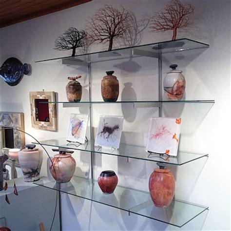 pole supported and wall mounted glass shelves rakks blog