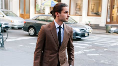 mens ponytails in a suit why i cut my man bun gq