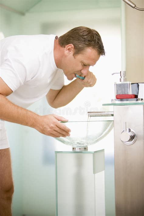 man bathroom man in bathroom brushing teeth royalty free stock images