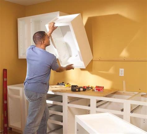 how to install kitchen cabinets how to install hanging cabinets for kitchen hanging