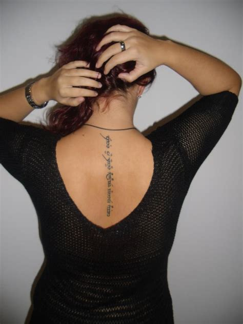 woman with tattoos back tattoos