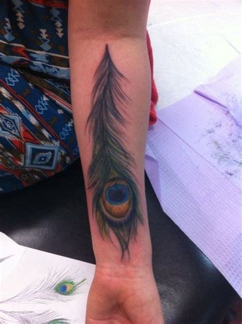 tattoo fixers peacock awesome peacock feather tattoo i like the realistic
