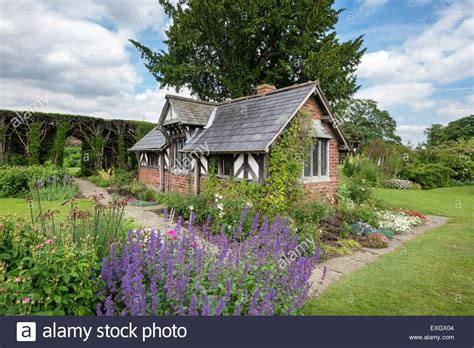 quaint cottage surrounded by flowers at arley gardens