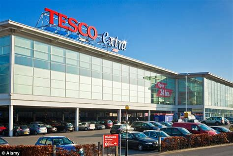 tesco bank in store tesco to reduce amount of 24 hour stores due to low number
