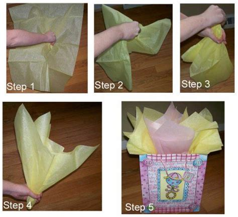 How To Fold Wrapping Paper Into A Bag - how to place tissue paper in a gift bag and make it look