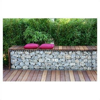 gabion bench bench made from wood and gabions backed by fargesia