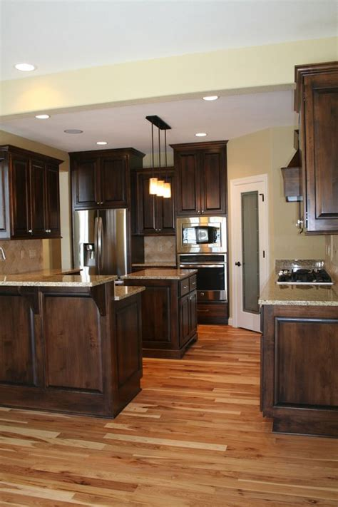 natural hickory floor kitchen alder wood cabinets stainless steel appliances and