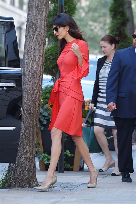 Amel Maroon amal clooney shows legs in wrap dress