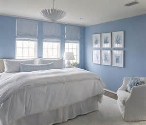 blue bedroom with blue coral gallery wall cottage