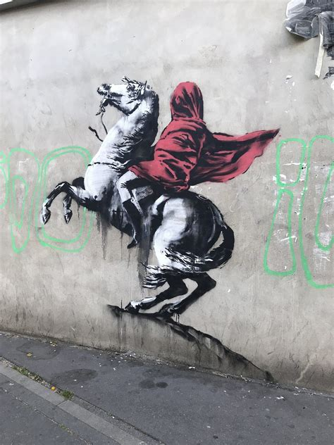 banksy hits paris  sharp political criticism