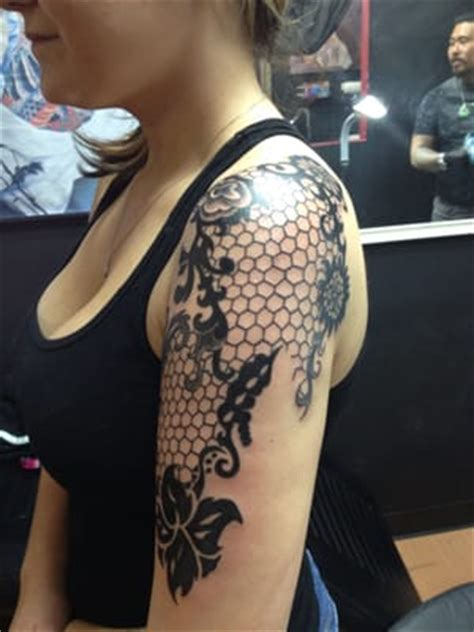 uv tattoo parlors near me my lace half sleeve done by hung he did it all by hand
