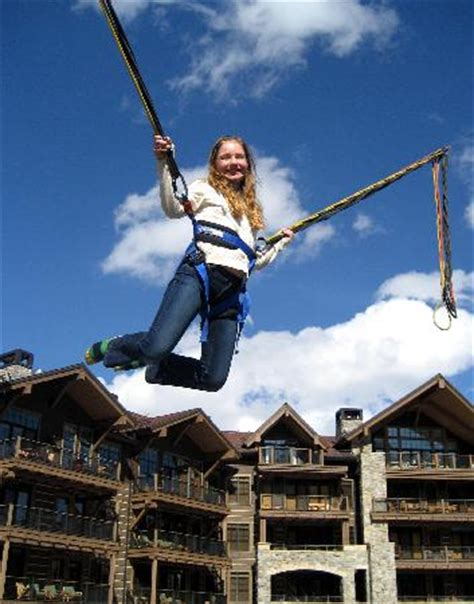 swing village com my daughter on bungee swing in the village picture of