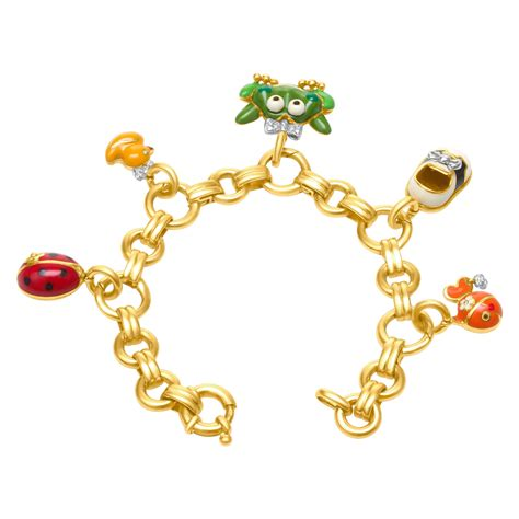 aaron basha charm bracelet 18k with 5 charms in 18k and