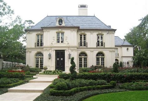 chateau style house plans french chateau french home exterior robert dame designs