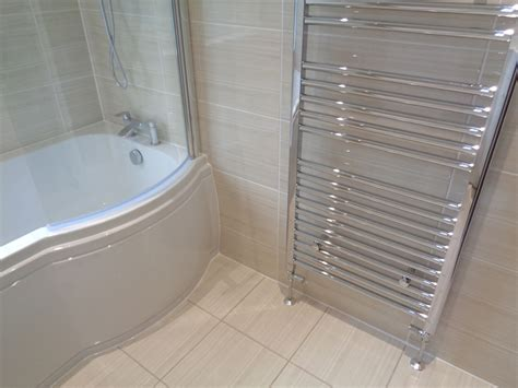 p shaped bath shower screen bathroom renovation with bath and luxury vanity basin and toilet
