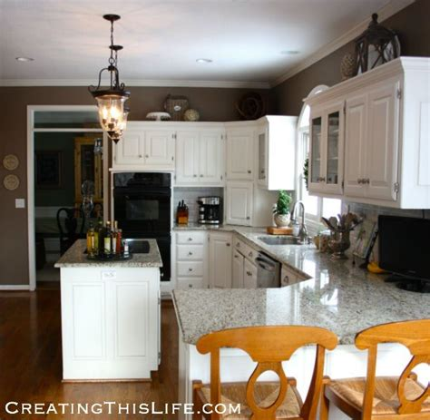 what to put on top of your kitchen cabinets things to put on top of your kitchen cabinets savae org