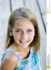 images teenage girl: young tween girl sitting on a pier royalty free stock photos image