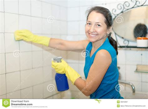 mature bathtub mature woman cleans bathroom royalty free stock