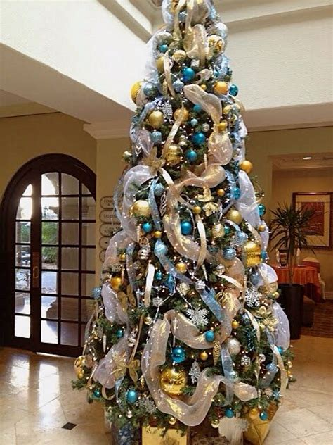 blue and silver cone christmas tree blue gold tree trees decor