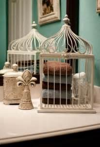 Yes you can make a vintage towel holder from a bird cage