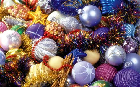 Colorful Baubles by Colorful Tinsel Between Sparkly Baubles Wallpaper