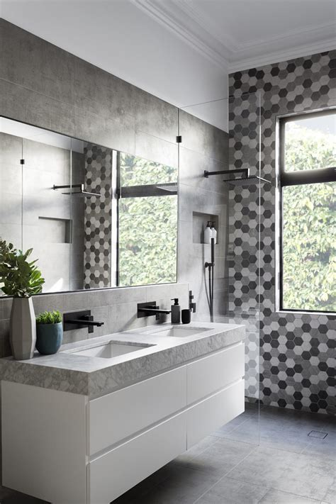 Modern Black And White Bathroom by Matte Black Accents Add Sophistication To This Grey And
