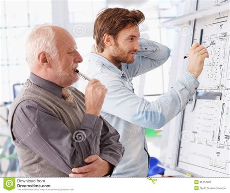 architects and designers young and senior architects working together stock image