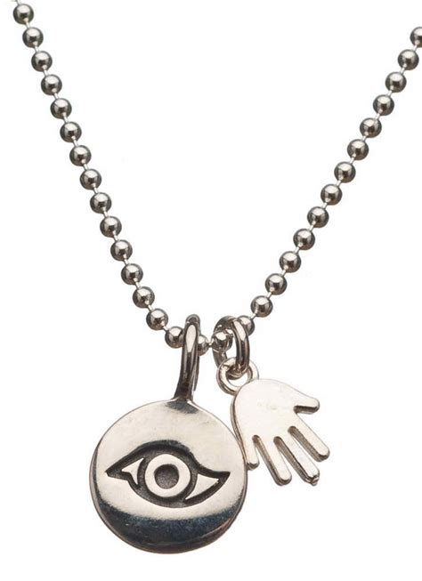 silver evil eye and hamsa necklace