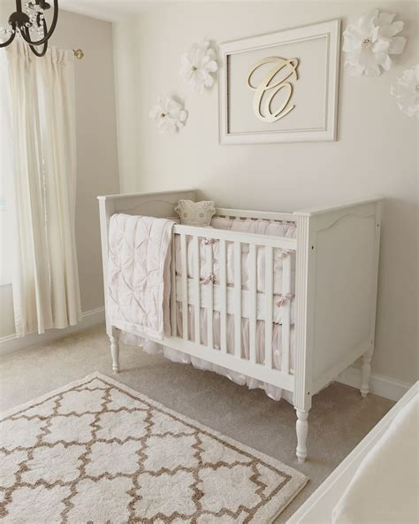 pottery barn baby curtains neutral white gold and blush pink nursery baby baby