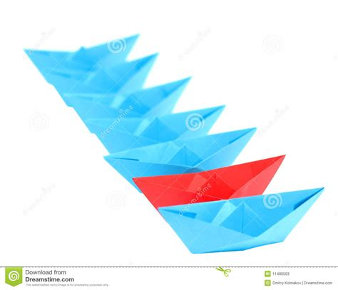 Origami Boats And Ships - origami ships standing in a row stock photos image