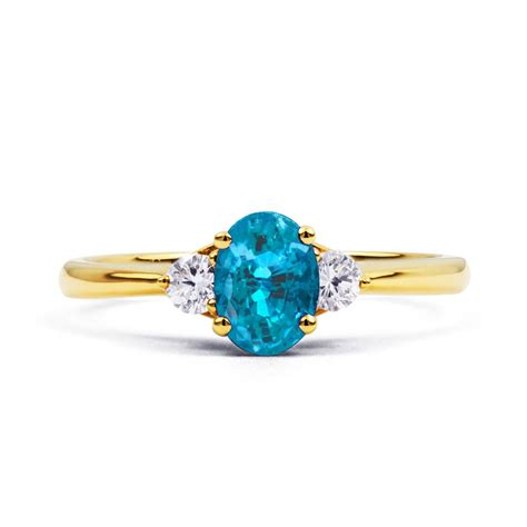 paragon blue topaz and engagement ring in