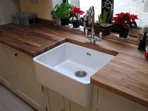 belfast ceramic sink set in rustic oak worktop kitchen