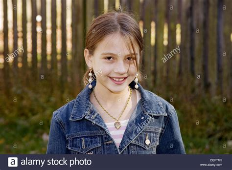 portrait of 10 year old girl stock photo getty images 10 year old girl standing in her backyard in annapolis