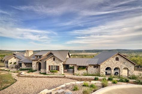 Romantic Hill Country Dream Farmhouse Exterior Austin by Schmidt Custom Homes