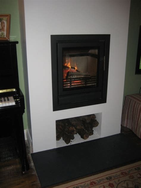 solid fuel in wall fireplace in west horsley surrey