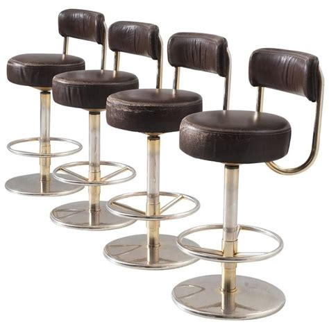 Colored Metal Bar Stools set of four bar stools in brass colored metal and brown