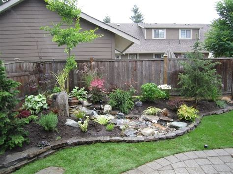 corner lot landscaping with stones outdoors
