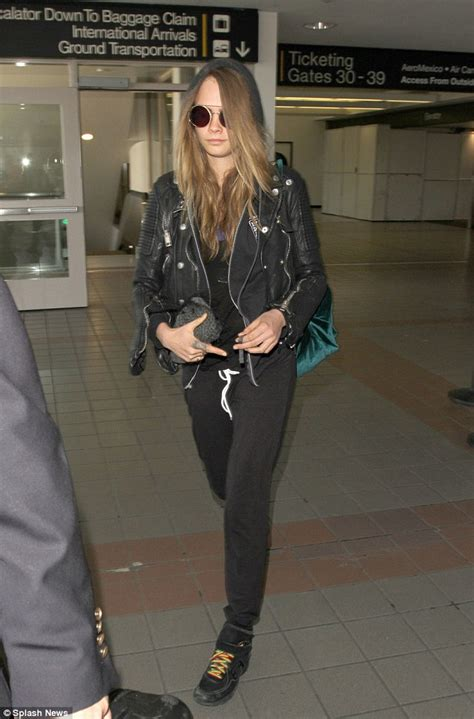 Skwad Jacket From Squad cara delevingne wears chanel kicks after margot robbie s squad daily mail