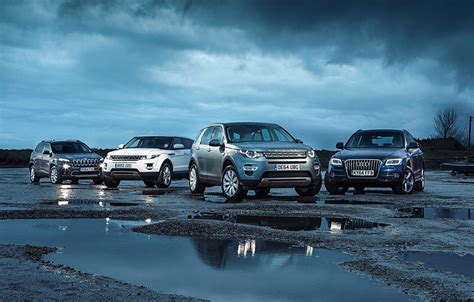 land rover jeep cars land rover discovery sport vs audi q5 vs jeep cherokee vs