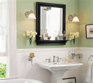 black framed bathroom mirrors white wainscoting with pale green walls black framed