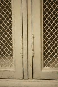 Cabinet Door Wire Mesh Large Cabinet In Distressed Grey Paint With Wire Mesh